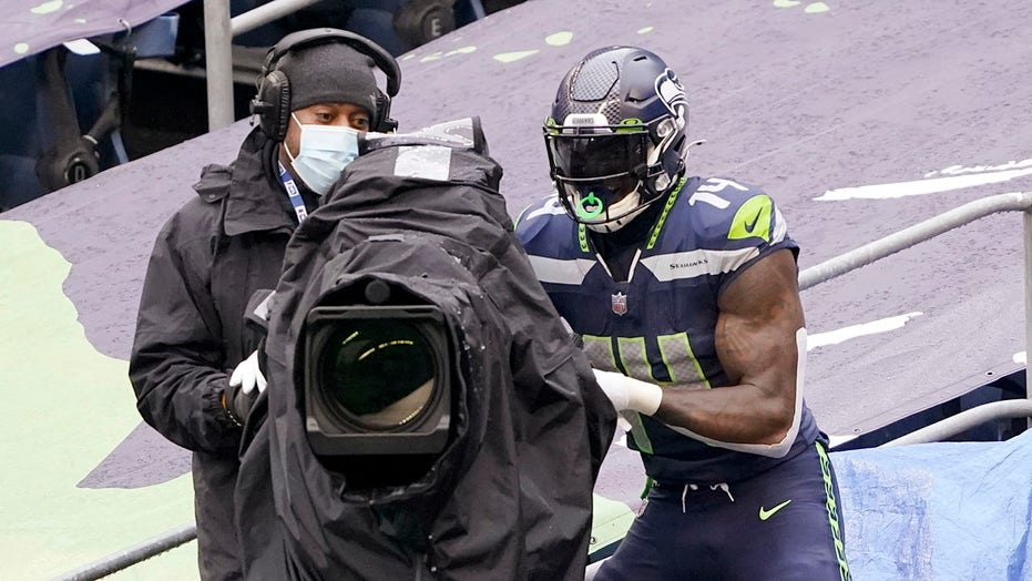 Seahawks' DK Metcalf celebrates TD with some light camera work, gets birthday card from teammates