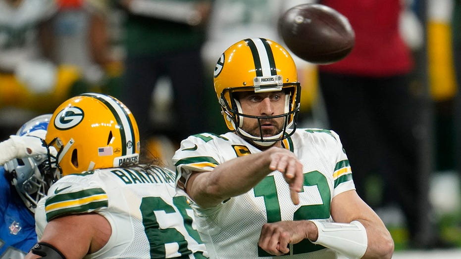 Rodgers-led Packers beat Lions 31-24, clinch NFC North title