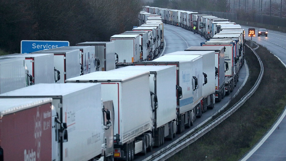 UK travel bans strand more than 1,500 France-bound trucks as governments work to reopen border