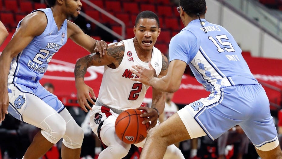 Daniels, N.C. State beat 17th-ranked North Carolina 79-76