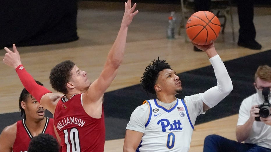 Louisville defeats short-handed Pitt 64-54