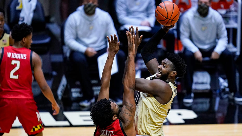 Newman scores 17, Purdue holds off Maryland 73-70