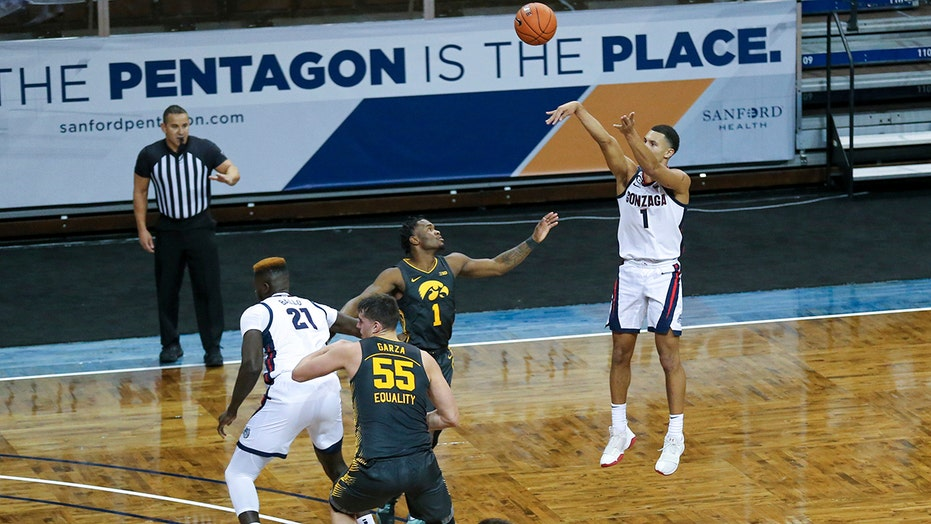 Suggs leads top-ranked Gonzaga over No. 3 Iowa 99-88
