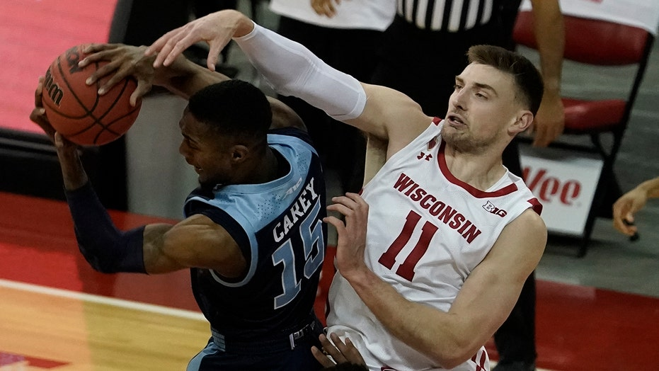 Davison leads No. 13 Wisconsin past Rhode Island 73-62