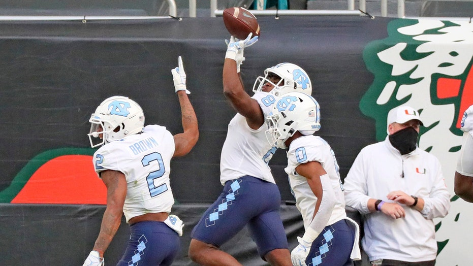 No. 20 UNC runs wild, rolls past No. 9 Miami 62-26