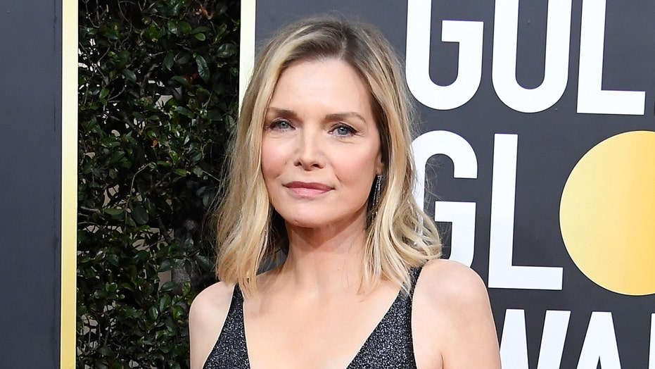 Michelle Pfeiffer shows off fiery red hairstyle for movie role