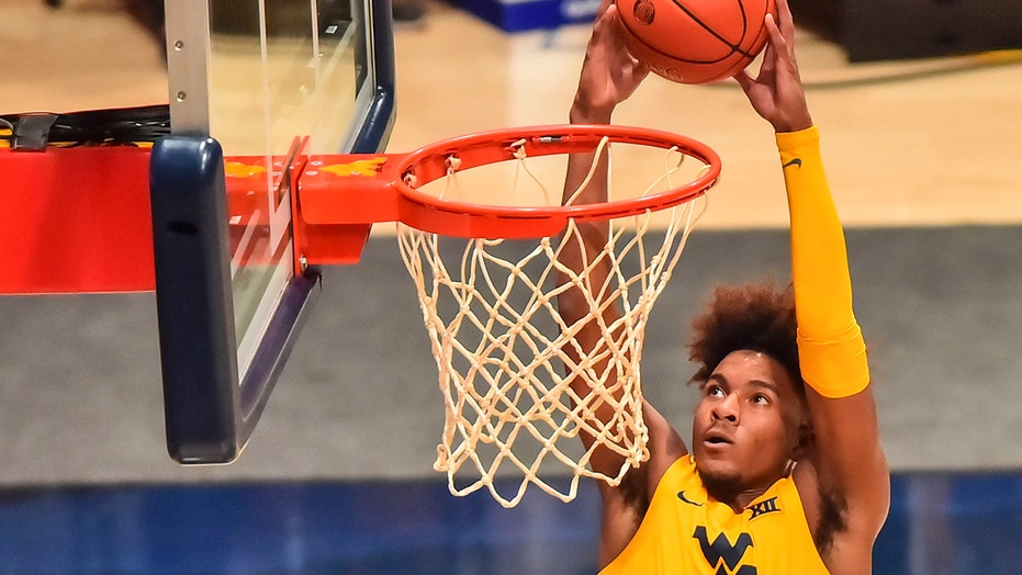 No. 8 West Virginia holds on to beat Iowa State 70-65