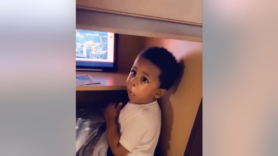 Toddler busted after creating secret hiding space in cabinet to watch cartoons, eat crackers