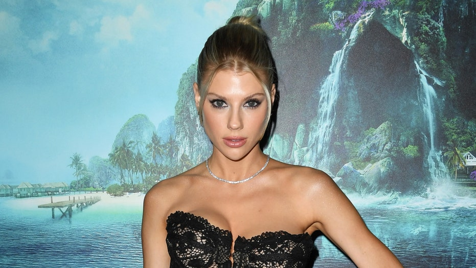 Model Charlotte McKinney flaunts abs in barely there bikini