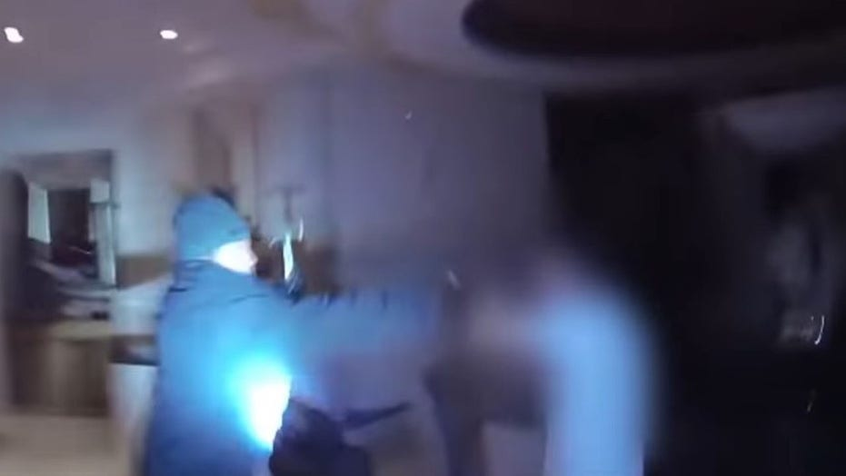 Bodycam footage captures Las Vegas officers shooting hammer-wielding burglary suspect