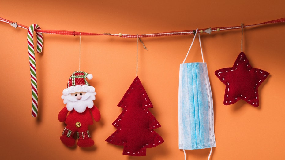 Healthcare workers decorate with PPE for the holidays this year