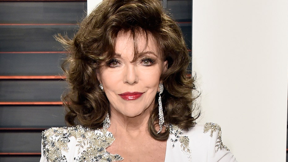 Joan Collins, 87, stuns in low-cut red dress in throwback Playboy cover