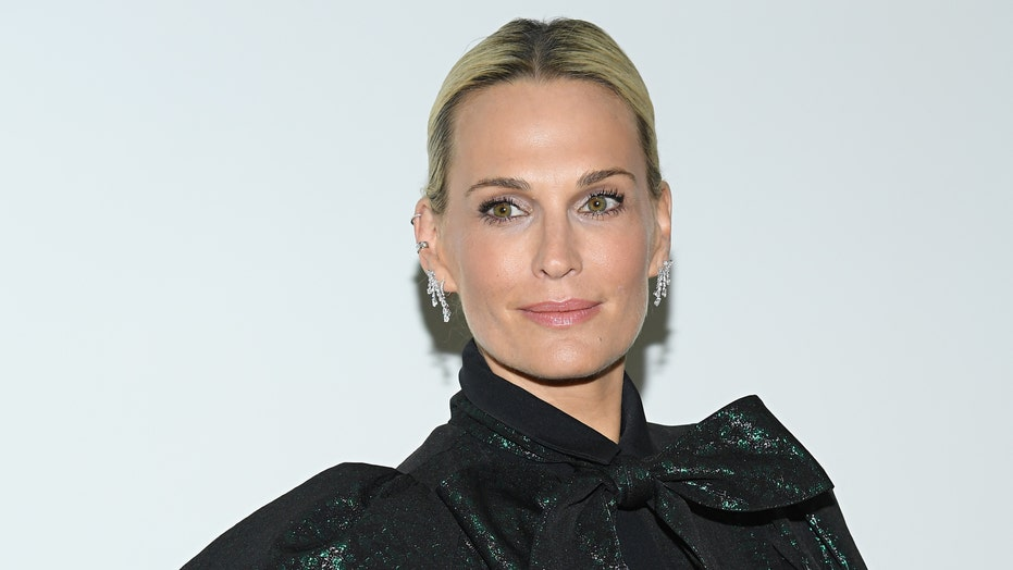 Molly Sims, 47, radiates in swimsuit on yacht: 'My last outfit before we quarantine'