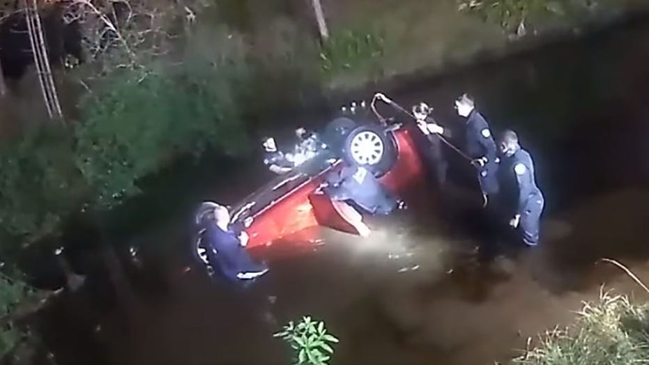 Florida family trapped inside overturned car in canal rescued by police, firefighters and good Samaritan