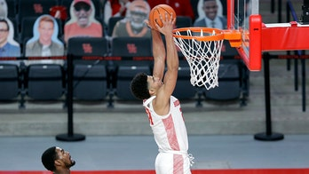 No. 11 Houston uses big first half to cruise past UCF 75-58