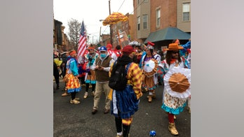 Defiant Mummers strut through South Philly despite parade cancellation