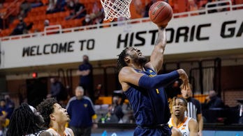 Culver leads No. 14 West Virginia from 19 down past Oklahoma State
