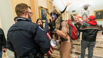 Man in bearskin headress in Capitol was booted from Navy over refusal of vaccine, report says