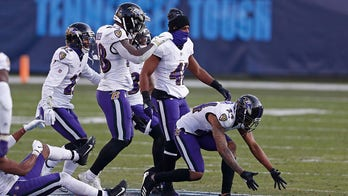 Ravens return favor to Titans by celebrating, stomping on logo during wild-card victory