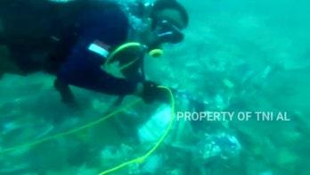 Indonesia navy divers hunt for crashed plane's black boxes