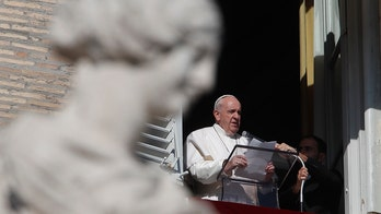 Pope Francis changes church law, grants women more access to altar