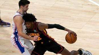Young's 26 points lead Hawks past short-handed 76ers, 112-94