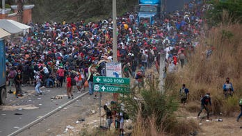 Migrant caravan member cites Biden's pledge to suspend deportations for 100 days as reason for traveling to US