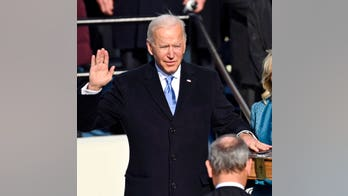 Biden enters White House with slight rise in poll numbers