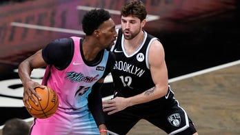 Durant, Irving help Nets hold off Adebayo, Heat 128-124