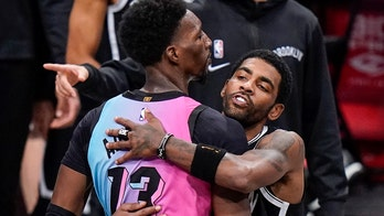 Kyrie Irving, Bam Adebayo postgame hug broken up amid NBA's tightened safety rules