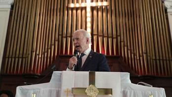 Catholic bishops approve Communion document aimed at possible rebuke of Biden