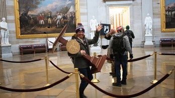 Adam Johnson, man seen carrying Nancy Pelosi's lectern during Capitol riot appears in court