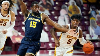With COVID-19 variant positives, Michigan pauses athletics
