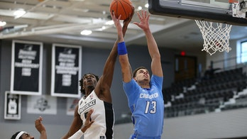 Late dunk lifts No. 11 Creighton to win over Providence