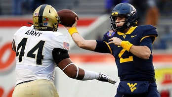 West Virginia rallies to beat Army 24-21 in Liberty Bowl