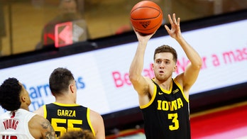 No. 10 Iowa wins 77-75 as free throws cost No. 14 Rutgers