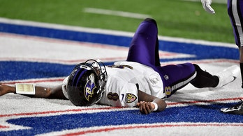 Ravens' Lamar Jackson hits head hard on turf, ruled out for rest of playoff game