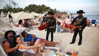 Mexico sees tourism bump as pandemic surges