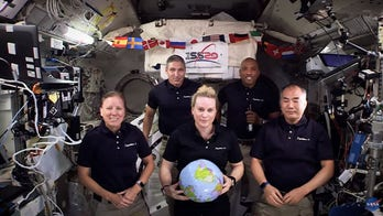 NASA ISS crew rings in New Year in space – with a zero-gravity twist
