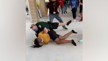Video shows officer slamming Florida high school student into ground during confrontation