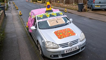 Neighbors throw birthday party for abandoned car that's been left on street for a year