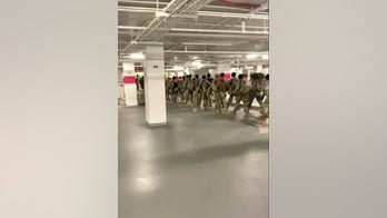 Madison Cawthorn delivers pizzas to National Guard troops in parking garage, vows they 'deserve respect''