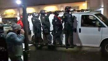 Portland protesters swarm police precinct after Jacob Blake decision, photos show 'press' being arrested