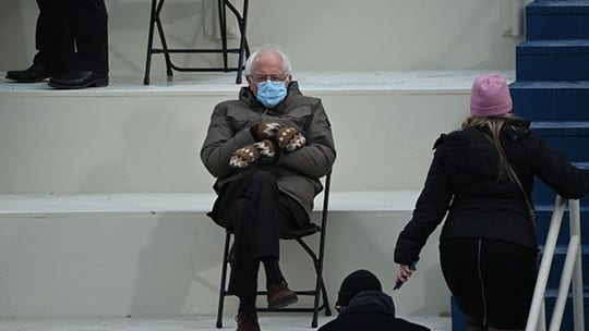 Photo of Bernie Sanders sitting alone in cold at Biden inauguration takes off