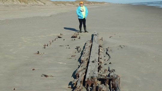 Mysterious shipwreck emerges from the sands of North Carolina beach