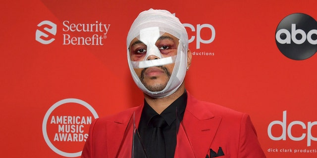 The Weeknd has appeared at a number of events wearing white bandages and artificial scarring. (Getty Images)