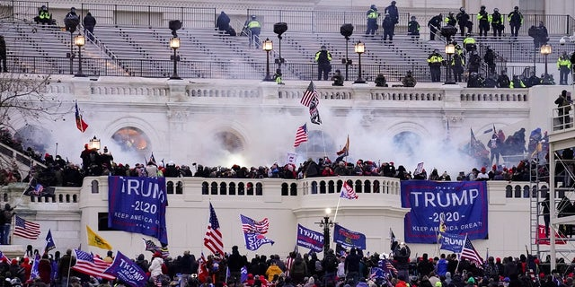 In this Wednesday, Jan. 6, 2021, file photo, violent protesters, loyal to President Donald Trump, storm the Capitol, in Washington. A Massachusetts teenager publicly called out her relatives after recognizing them as possible rioters during last week's riot in Washington D.C.. (AP Photo/John Minchillo, File)