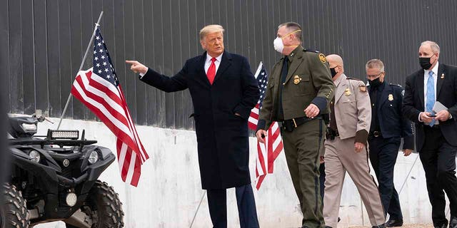 President Donald Trump tours a section of the U.S.-Mexico border wall, Tuesday, Jan. 12, 2021, in Alamo, Texas. (Associated Press)