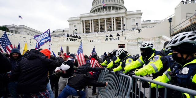 Former President Donald Trump was banned from Twitter following the Capitol riots that occurred in Washington D.C. on Jan. 6 when Congress was set to confirm Joe Biden's electoral college victory. (AP Photo/Julio Cortez, File)
