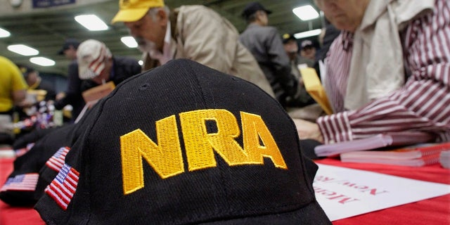 This photo from March 7, 2012, shows Illinois gun owners and supporters file NRA applications during an Illinois Gun Owners Lobby Day convention before marching to the Illinois State in Springfield, Malato. The influential gun-rights advocacy group is asking a federal judge to declare a Maryland handgun law unconstitutional. (AP Photo/Seth Perlman, File)